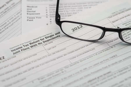 Tax Form and Glasses