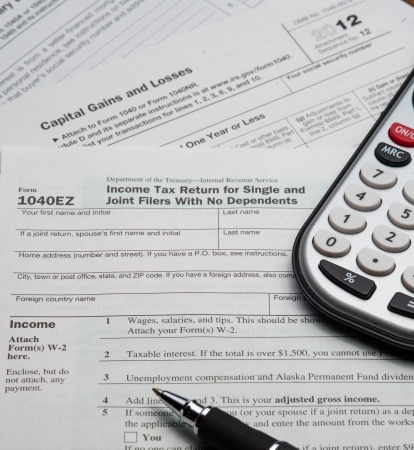 phillip rubino: Several Tax Forms along with a Calculator Stock Photo