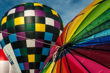 Colorful hot air balloons inflating