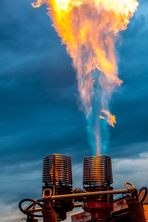 Hot air balloon burner lighting up the sky Stock Photo