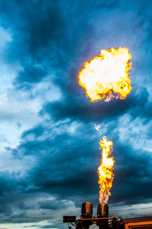 Hot air balloon burners lighting up the cloudy sky Stock Photo