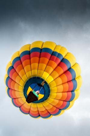 Looking up at a colorful hot air balloon