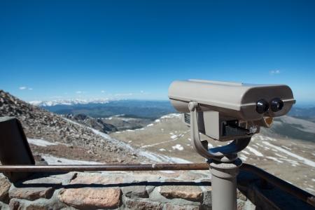 phillip rubino: Visitor binoculars with a rocky mountain vista Stock Photo