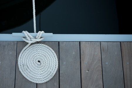 Image of a dock with a coiled boat line Stock Photo