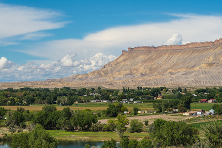 mesas: View of Cliff Mesas from Palisades Colorado vineyard at grape harvest on summer afternoon Stock Photo