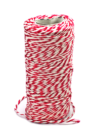 red and white corduroy rope roll stand upright isolated on white background Stock Photo
