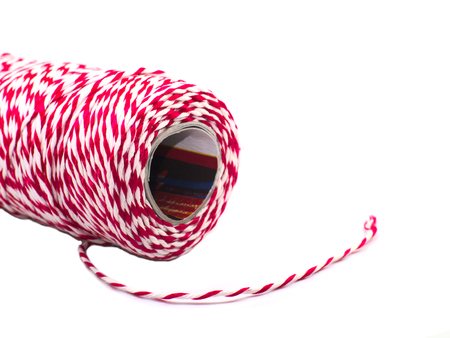 red and white corduroy rope roll