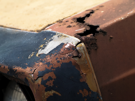 decayed: decayed and rusty metallic surface on a car radiator hood Stock Photo