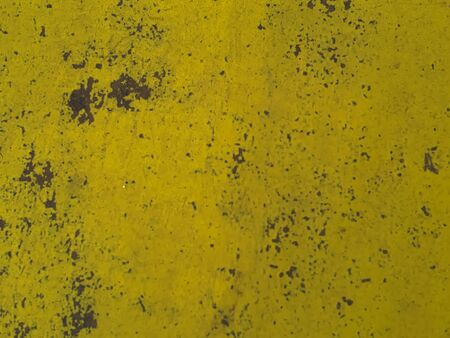 aged and decayed yellow metal surface