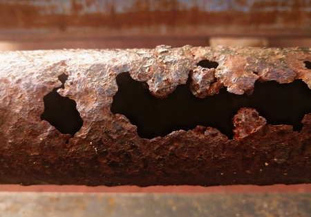 corroded: closeup shot of corroded and rusty metal pole