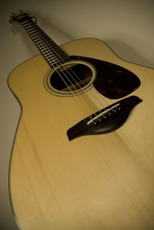 An acoustic guitar is a guitar that uses only acoustic methods to project the sound produced by its strings. photo