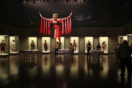 minority: Shanghai, China - March 31, 2010 - Shanghai Museum Minority traditional clothing exhibition