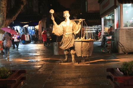 hawker: Street hawker statue at Nanjing Fuzimiao market area