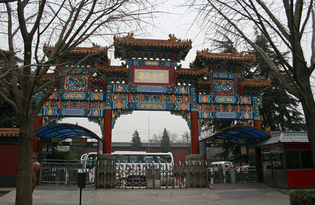 tourist attraction: A traditional Chinese gate, at the entry to a tourist attraction with a bus setting down Editorial