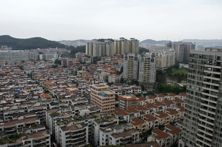lowrise: Humen, China - March 10, 2010 -  Blocks of low-rise and hi-rise residentail homes in Humen Town