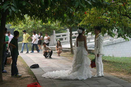 the crags: Zhaoqing, China - May 10, 2012 -  Photographers taking wedding photos on Seven Star Crags Park Editorial