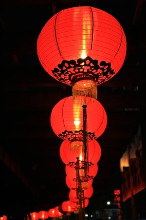 A row of Chinese red lanterns at night