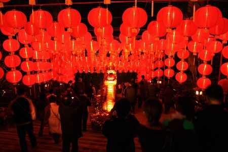 Shenzhen, China - February 3, 2011 -  A grid of Chinese red glowing lanterns greets tourists on their night arrival to Splendid China theme park in Shenzhen Editorial