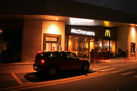 Shenzhen, China - May 2, 2012 - A car pulls up to the drive through window at a McDonalds in Shenzhen Editorial