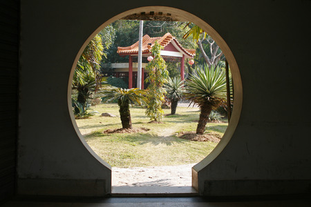 Chinese garden door leading to the graden grounds and pavilion at Shenzhen Xianhu Botanical Garden