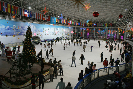 Shenzhen, China - December 31, 2010 - People go Ice Skating on New Years Eve at Alps Ski World