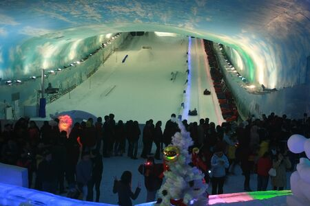 Shenzhen, China - December 31, 2010 - People go Snow Boarding on New Years Eve at Alps Ski World 報道画像