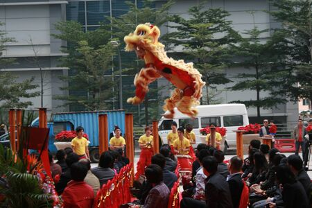 Shenzhen, China - December 12, 2010 - A lion dance takes place at a company opening in Shenzhen