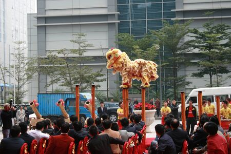 Shenzhen, China - December 12, 2010 - A lion prepares to take the jump at a lion dance show for a company opening in Shenzhen