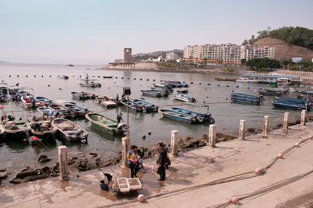 dong: Shenzhen, China - March 26, 2012 - Fishing boats docked at Dong Sheng Fishing Village