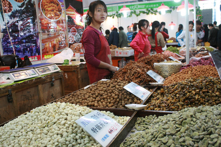 january 1: Shenzhen, China - January 1, 2011 - A stall selling nuts at a New Years Market in China