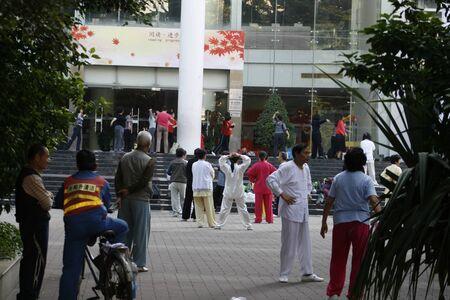 Shenzhen, China - May 10, 2010 -  People practicing Tai Chi in a public square in Nanshan District of Shenzhen China
