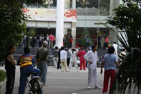 Shenzhen, China - May 10, 2010 -  People practicing Tai Chi in a public square in Nanshan District of Shenzhen China