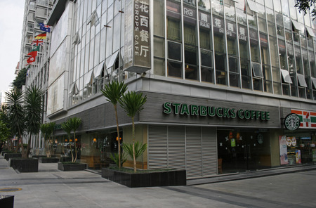 Shenzhen, China - November 24, 2010 - A Starbucks store located in Futian District of Shenzhen