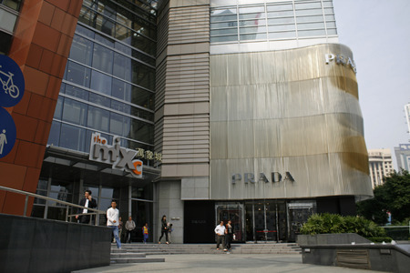 Shenzhen, China - November 24, 2010 - Mixc shopping mall and PRADA store facade