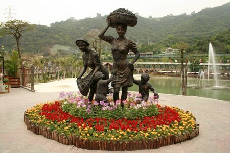 Shenzhen, China - April, 3 2010 - A statue of women and children at OCT East Theme park