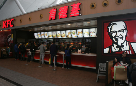 Shenzhen, China - January 20, 2015 - People buying KFC at an outlet at Shenzhen North Train station Editorial