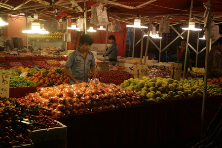 Shenzhen, China - January 20, 2015 - A street market stall selling fruit in Pingzhou, Baoan, Shenzhen China Editorial