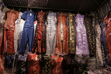 Traditional Chinese dresses for sale at a market