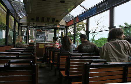 Hong Kong, China - April 8, 2010 - Travelling up Victoria Peak inside the Peak Tram