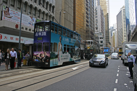 ding: Hong Kong, China - April 9, 2010 - Ding Ding Tram travelling the streets of Central