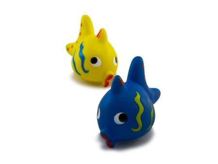 fish toy: bambini pesce giocattolo su uno sfondo bianco