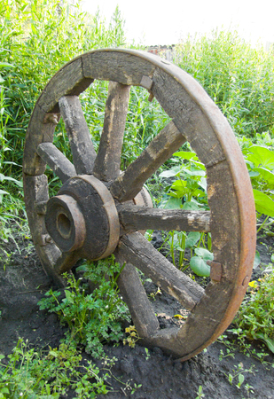 circle objects: old wheel on a background of green grass Stock Photo