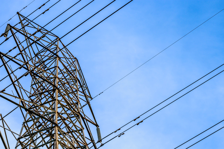 Close up view of high voltage tower with cables