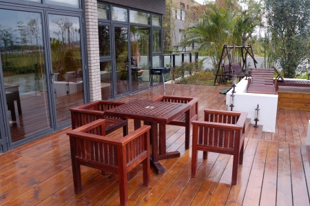 lawn party: House patio with wooden table and chairs