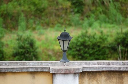 street lamp on the wall with green backgound photo