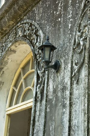 Old street lamp on the wall photo