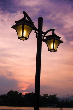 Street light with sunset photo