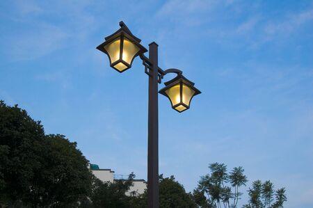 lighting street lamp with blue sky photo