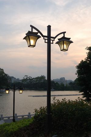 street lamp with sunset in the park photo