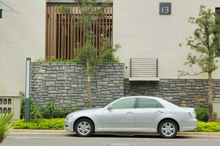 asian house plants: Street scene in a chinese new residential district. New car,new tree,new building ...,all is new. Stock Photo
